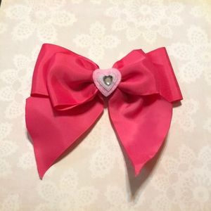 Pink bow with a heart in the middle